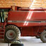 Farm equipment sits in storage